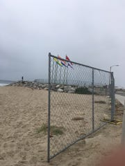 A portion of Port Hueneme's beach is closed for a dredging operation. The area will be closed through March.