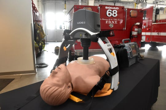 A mechanical chest compression device pumps the chest of a mannequin after a ceremony at Oxnard Fire Station No. 8 on Dec. 17 to announce the implementation of the city's new Squad 68, which is aimed at reducing medical response times in south Oxnard.