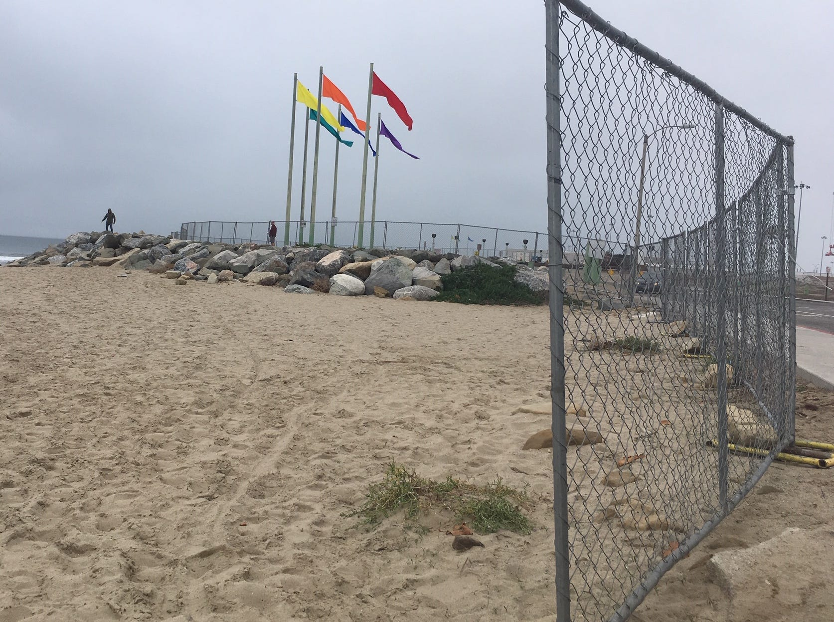 A fence signals a section of Port Hueneme's coastline is off-limits as the Army Corps of Engineers works on a dredging project.