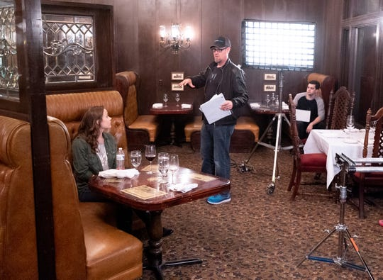 """Matt Sconce, center, directs lead actress Megan Barker as production crew members set up lights and camera in the Depot Restaurant in Visalia for scenes in """"Killing Kate"""" on Sunday, December 16, 2018. The resulting fast-paced action/thriller short will be used to pitch for a feature-length film and tour the festival circuit according to backstage.com."""