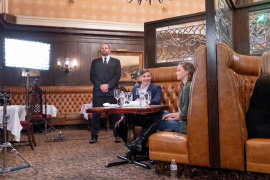 """Actors Megan Barker, right, Daniel O'Reilly and Ryan Kos take positions on set as the production crew adjusts lights and camera in the Depot Restaurant in Visalia for scenes in """"Killing Kate"""" on Sunday, December 16, 2018. The resulting fast-paced action/thriller short will be used to pitch for a feature-length film and tour the festival circuit according to backstage.com."""