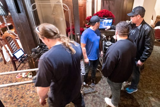 """Matt Sconce, right, directs the production crew in the Depot Restaurant in Visalia for scenes in """"Killing Kate"""" on Sunday, December 16, 2018. The resulting fast-paced action/thriller short will be used to pitch for a feature-length film and tour the festival circuit according to backstage.com."""