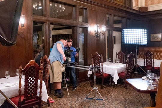 "Production crew members set up lights and camera in the Depot Restaurant in Visalia for scenes in ""Killing Kate"" on Sunday, December 16, 2018. The resulting fast-paced action/thriller short will be used to pitch for a feature-length film and tour the festival circuit according to backstage.com."