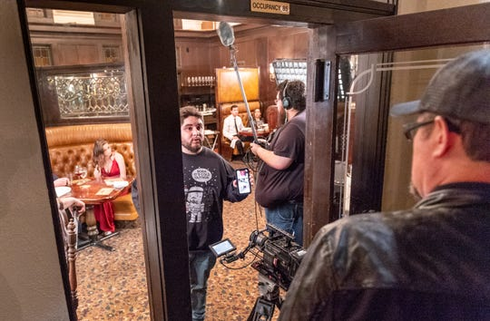 """A production crew sets up lights and camera in the Depot Restaurant in Visalia for scenes in """"Killing Kate"""" on Sunday, December 16, 2018. The resulting fast-paced action/thriller short will be used to pitch for a feature-length film and tour the festival circuit according to backstage.com. Megan Barker is at left."""