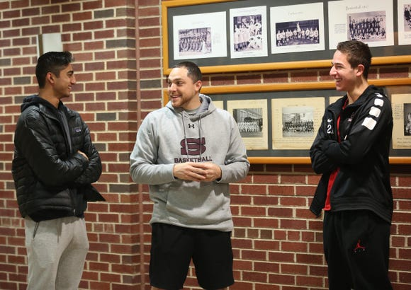 Scarsdale boys basketball coach Joe Amelio talks with Jayshen Saigal and Cole Kattan before practice at Scarsdale High School Dec. 14, 2018.
