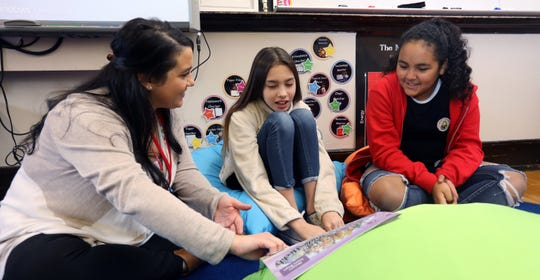 Long-term substitute teacher Gia Accattato with sixth-graders Eva Lanzillotti and Ariana Reyes at Haverstraw Elementary School Dec. 17, 2018.