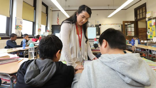 Gia Accattato helps students with a reading lesson in her sixth-grade class at Haverstraw Elementary School Dec. 17, 2018. She is a long-term substitute teacher.