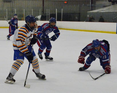 Mahopac forward Brian O'Shea sets up for a wrister during the second period of a 9-7 win over Carmel on Sunday, December 16, 2018, at Brewster Ice Arena.