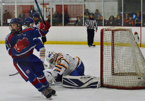 Carmel forward Luke Golisano launches into celebration mode after giving the Rams a 3-2 lead in the first period of Sunday's game against rival Mahopac.