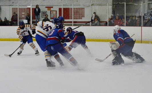 Mahopac forward Brian O'Shea sets up to shoot through a crowd in the second period on Sunday.