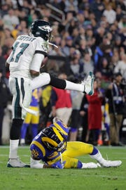 Philadelphia Eagles wide receiver Alshon Jeffery celebrates after a catch over Los Angeles Rams free safety Lamarcus Joyner during the second half in an NFL football game Sunday, Dec. 16, 2018, in Los Angeles. (AP Photo/Jae C. Hong)