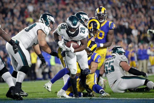 Philadelphia Eagles running back Wendell Smallwood scores against the Los Angeles Rams during the second half in an NFL football game Sunday, Dec. 16, 2018, in Los Angeles. (AP Photo/Jae C. Hong)