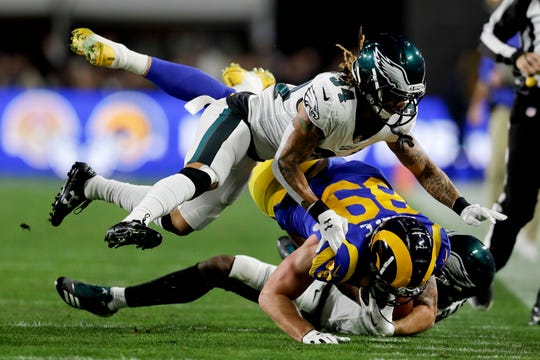 Los Angeles Rams tight end Tyler Higbee is tackled by Philadelphia Eagles cornerback Cre'von LeBlanc, top, and cornerback Rasul Douglas during the first half in an NFL football game Sunday, Dec. 16, 2018, in Los Angeles. (AP Photo/Marcio Jose Sanchez)