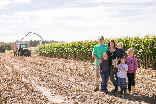 Travis and Melissa Marti are the third generation owners of Marti Farms near Vesper, Wis., buying the farm from Travis' parents in 2010.  Joining them in their agricultural endeavor are their children, Chloe, 8, Ryan, 3,  Jacob, 6, and Allison, 10.  The family currently milks 410 cows and operates 1100 acres of cropland.