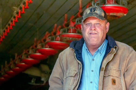 """In this Nov. 21, 2018, photo provided by the Midwest Center for Investigative Reporting, Kevin Kemp poses for a photo at his chicken farm near Carthage, Miss. After 20 years, Kemp is getting out of the chicken business. He raised millions of pounds of chicken since 1996, alongside his father and brother. But Kemp said even though he's done well as a poultry grower, raising chickens is """"not all it's cracked up to be."""""""