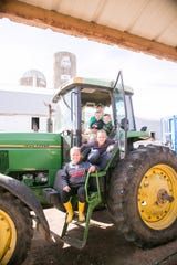 Travis Marti (top) and his wife, Melissa, want to be able to share farm life with their young children, (from top) Ryan, Jacob, Chloe and Allison.