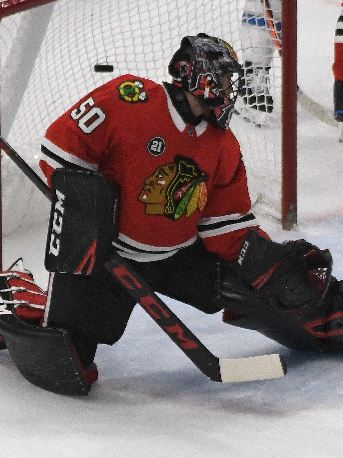 Chicago Blackhawks goaltender Corey Crawford left Sunday's game against the San Jose Sharks with 1:30 left in the first period.