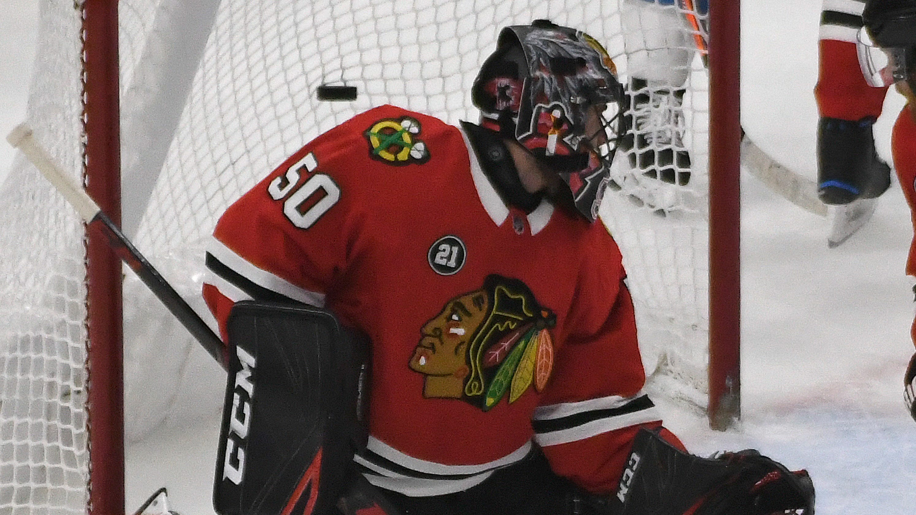 Blackhawks goalie Corey Crawford suffers concussion after slamming head  into goal post bfc256a00