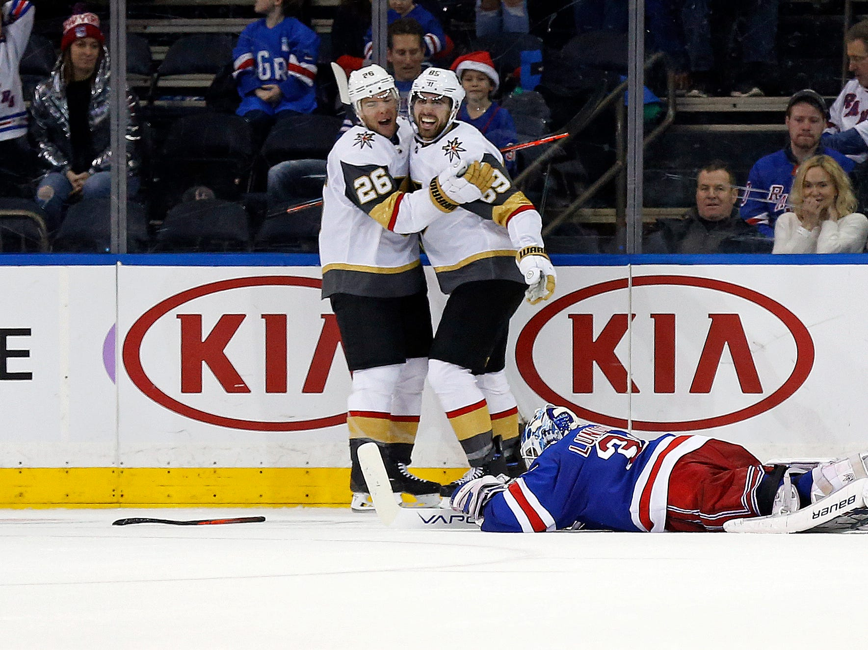 Dec 16: New York Rangers goaltender Henrik Lundqvist sprawls on the ice after giving up the game winning goal in overtime to Vegas Golden Knights right wing Alex Tuch (89), who celebrates with Paul Stastny (26) in  Madison Square Garden.
