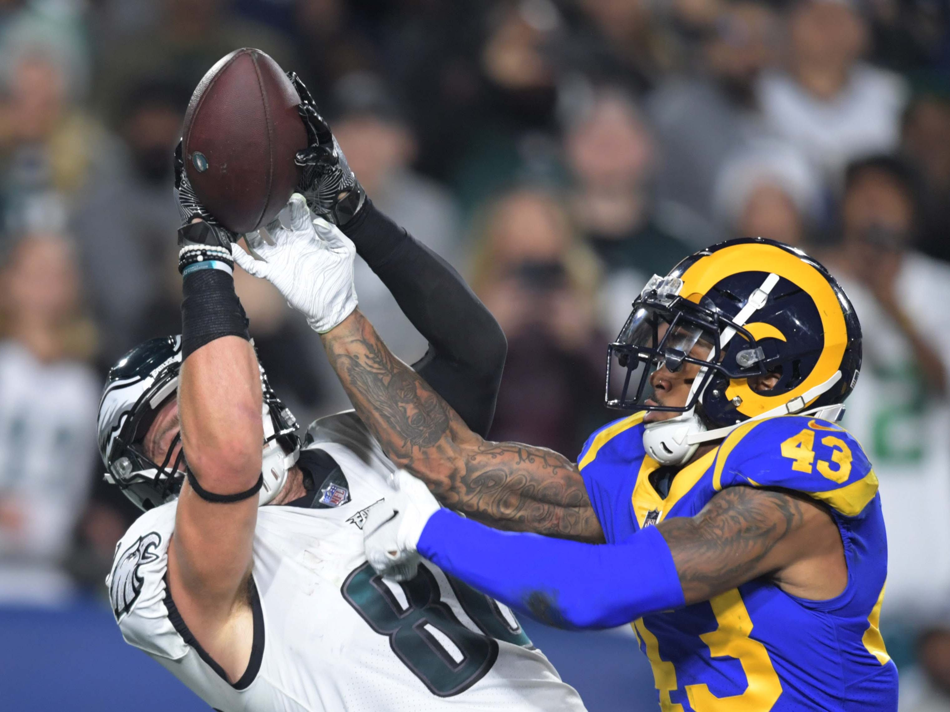 Los Angeles Rams strong safety John Johnson (43) defends as Philadelphia Eagles tight end Zach Ertz (86) attempt to make a catch during the first half at Los Angeles Memorial Coliseum.