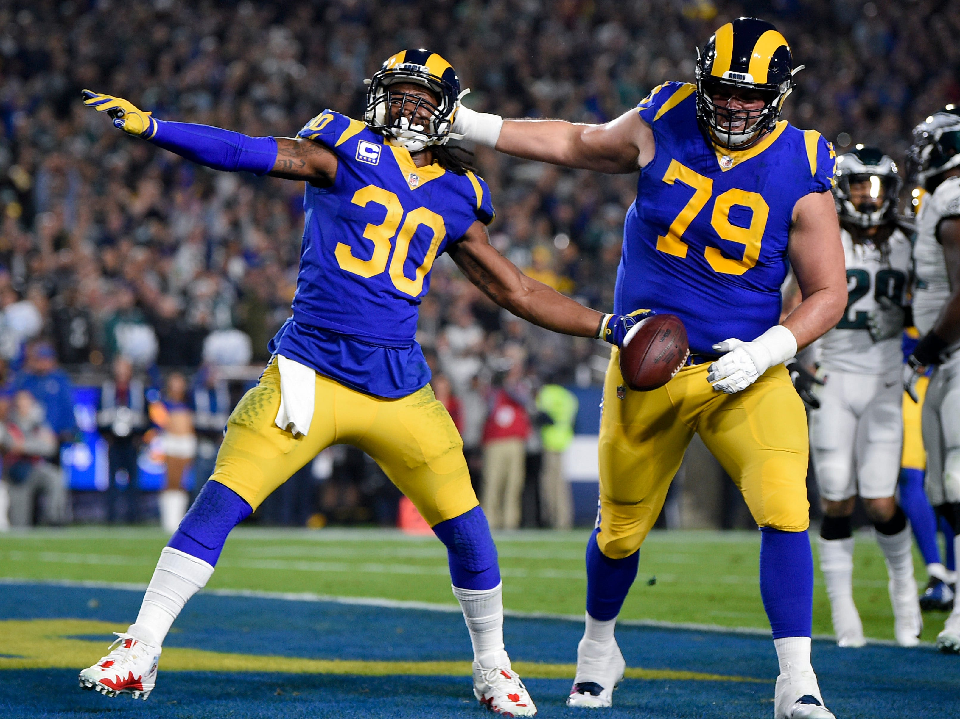 Los Angeles Rams running back Todd Gurley celebrates his touchdown run during the first half against the Philadephia Eagles at Los Angeles Memorial Coliseum.