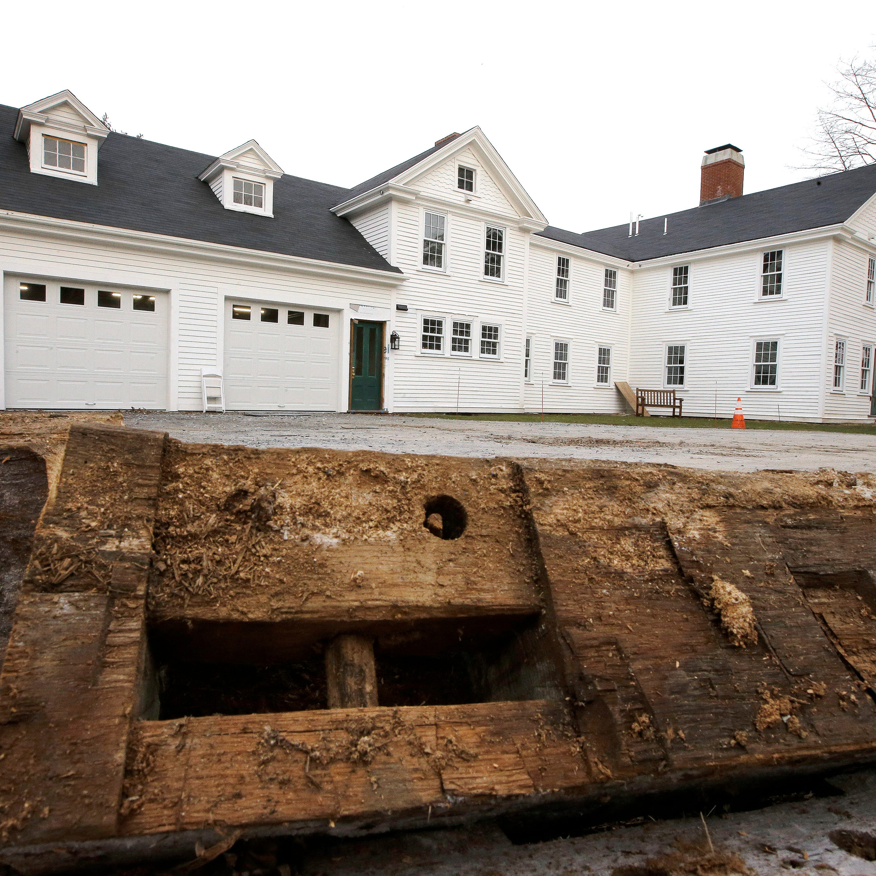 A discarded beam rests in the driveway of the home where Sarah Clayes lived, in Framingham, Mass., after leaving Salem, Mass., following the 1692 witch trials.