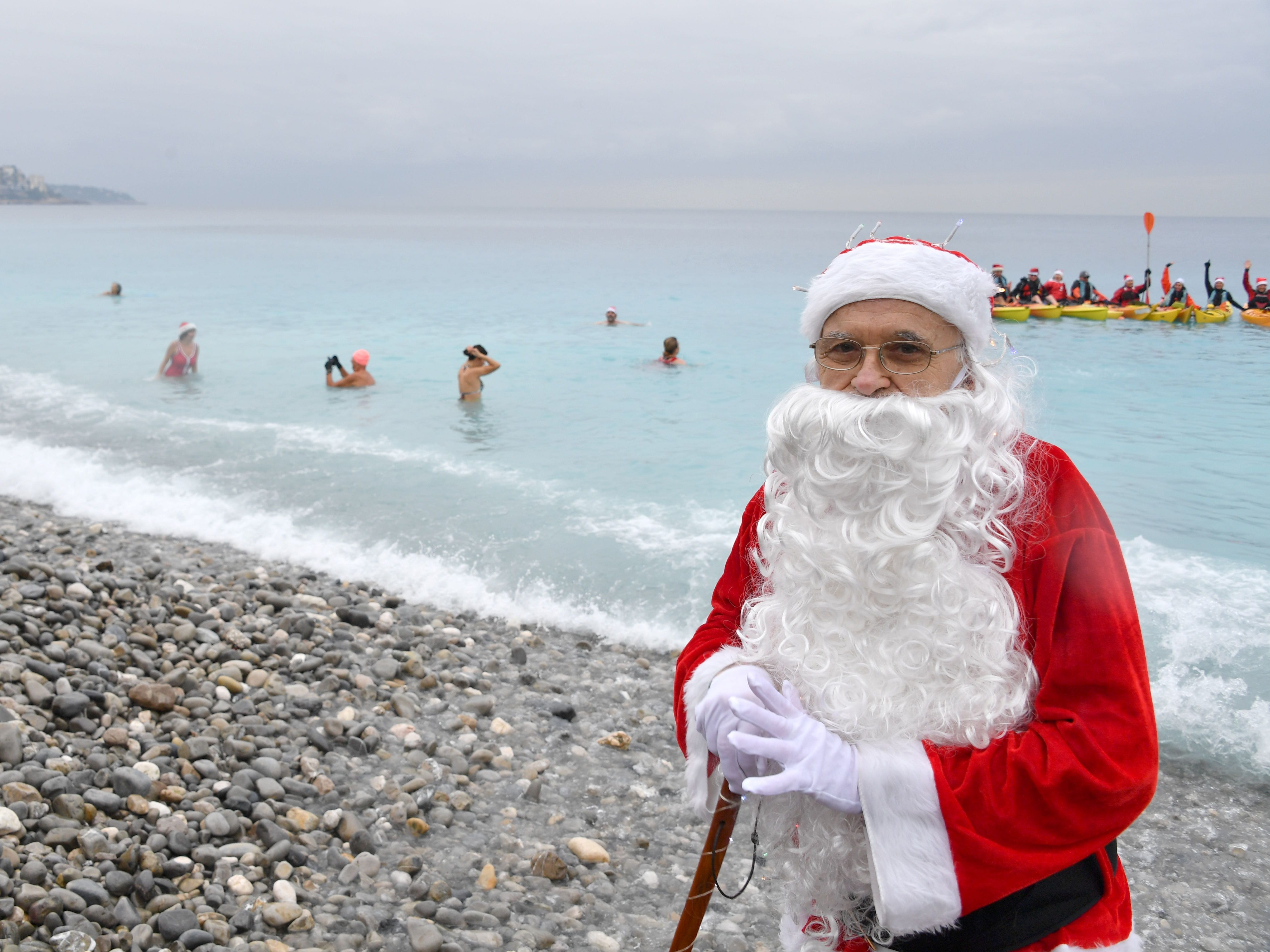 A man dressed as Santa Claus poses as he takes part in a traditional Christmas bath on Dec.16, 2018, in Nice, France.