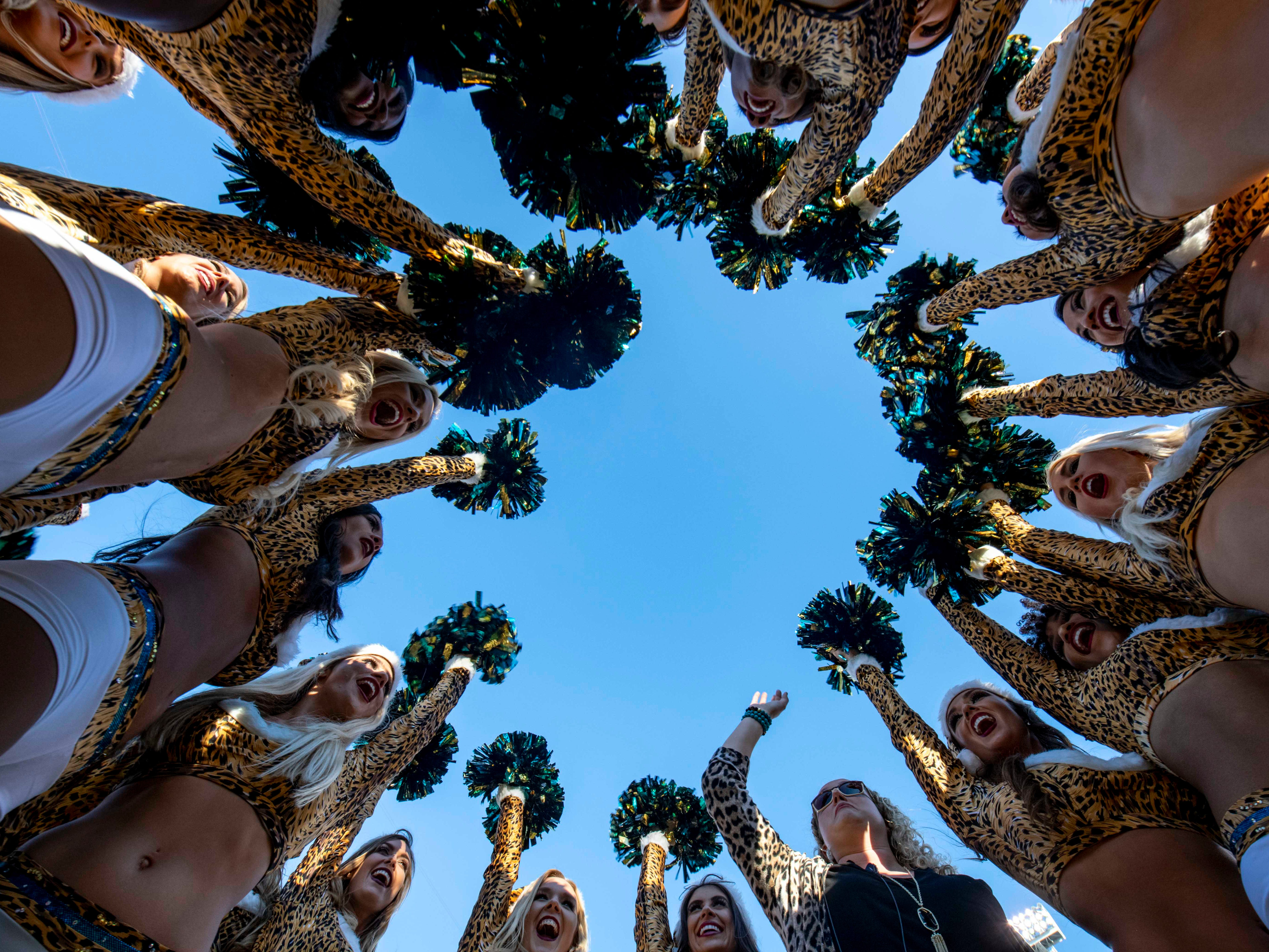 Week 15: Jacksonville Jaguars cheerleaders make a final cheer in a huddle after the last home game of the season at TIAA Bank Field. The Washington Redskins won the game, 16-13.