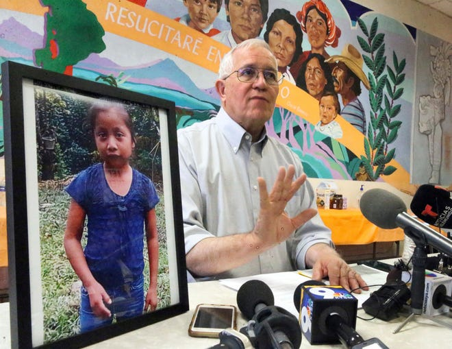 Annunciation House director Ruben Garcia answers questions from the media after reading a statement from the family of Jakelin Caal Maquin, pictured at left, during a press briefing at Casa Vides, on Dec. 15, 2018, in El Paso, Texas.