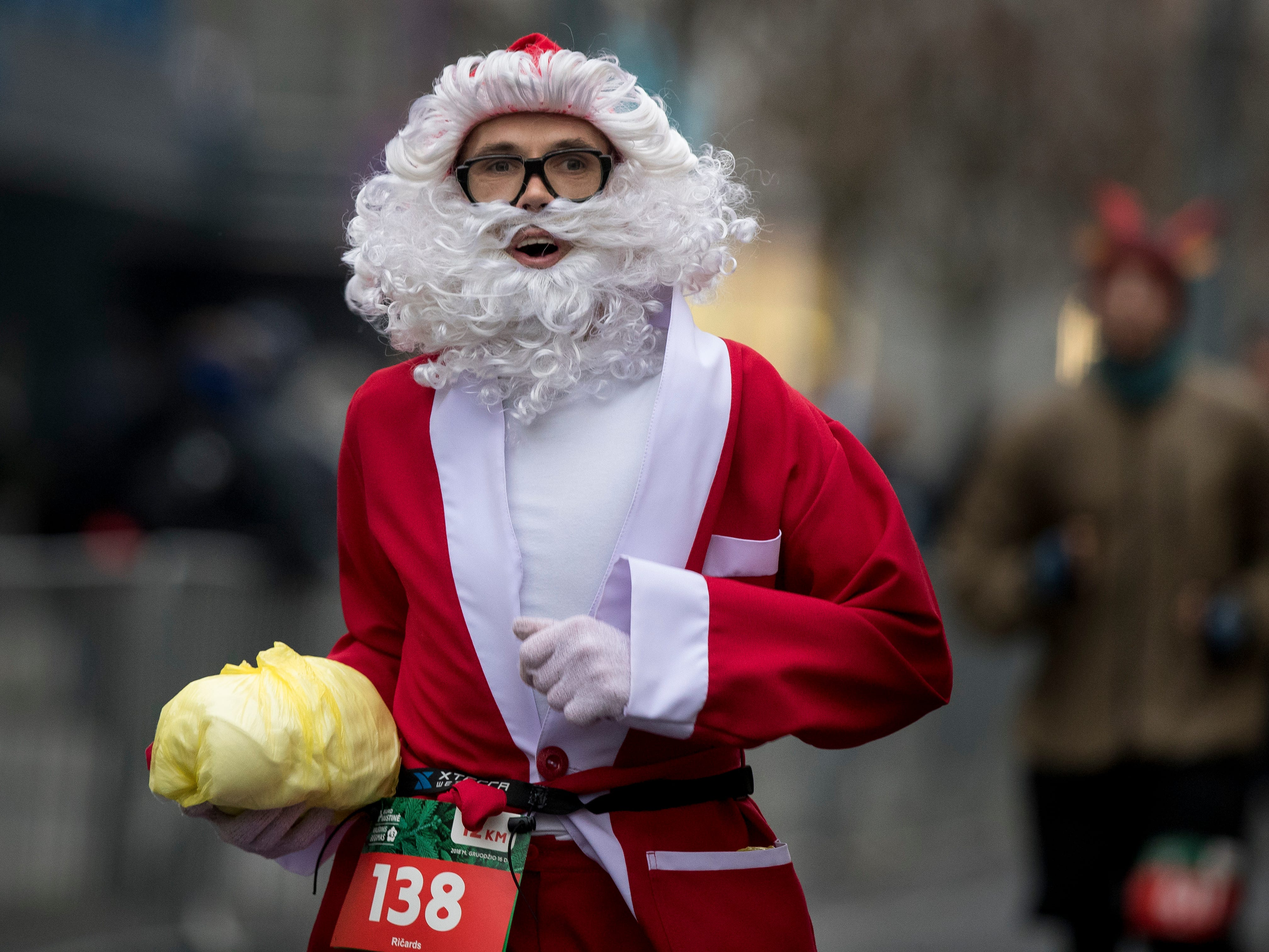 A man dressed like Santa Claus take part in the traditional seasonal Christmas run along the streets of Vilnius, Lithuania, Dec. 16, 2018. The festive run attracts many hundreds of people to the capital dressed as Santa Claus to take part in the sporting event.