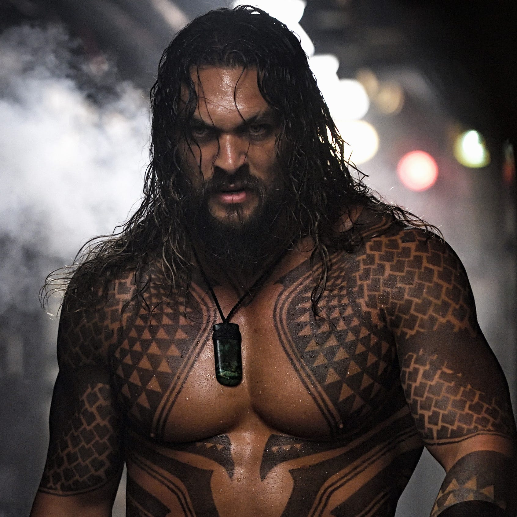 "Jason Momoa strikes a muscular figure as the title hero of ""Aquaman."""