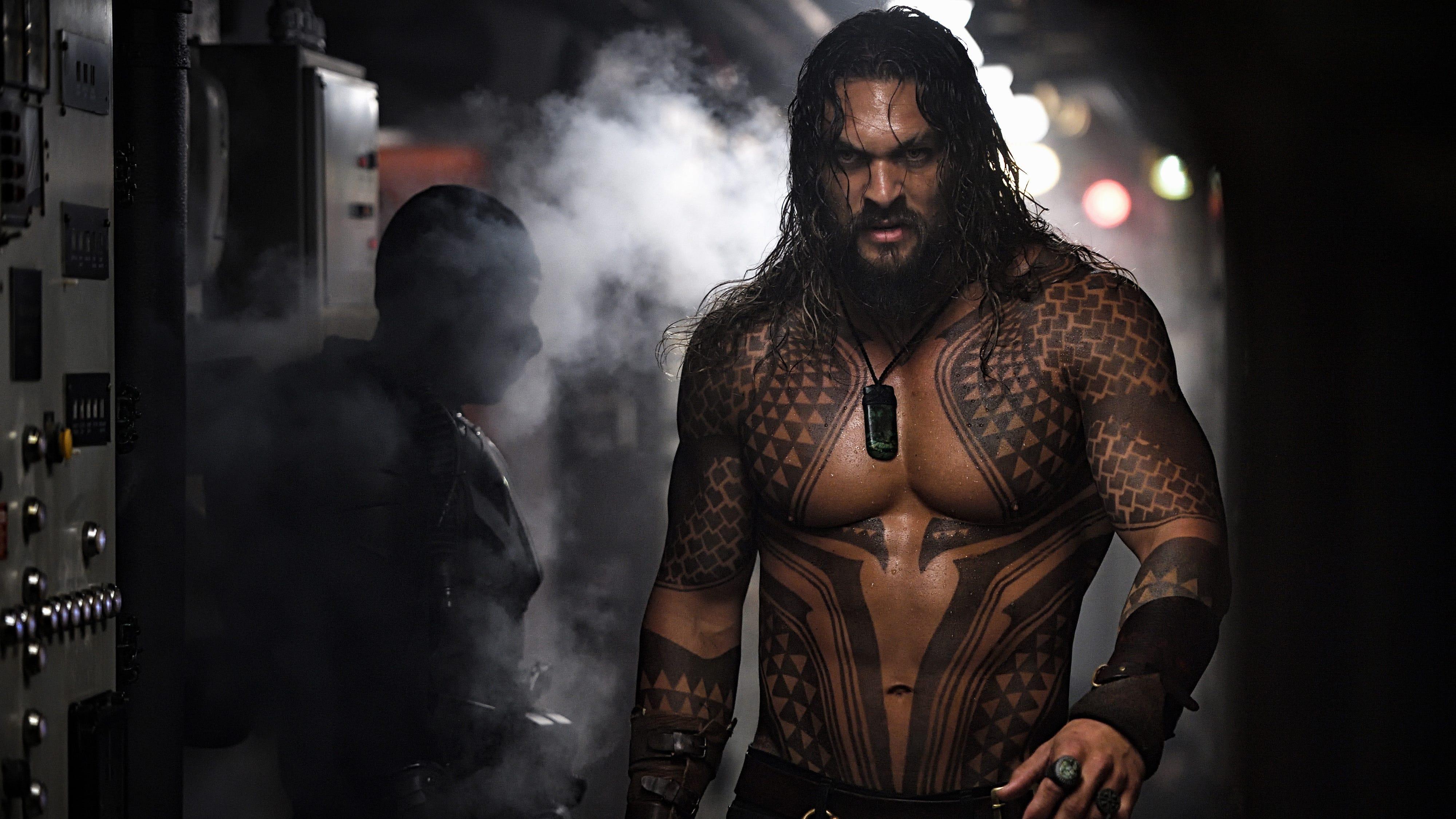 "Jason Momoa strikes a muscular figure as the title hero of ""Aquaman."""