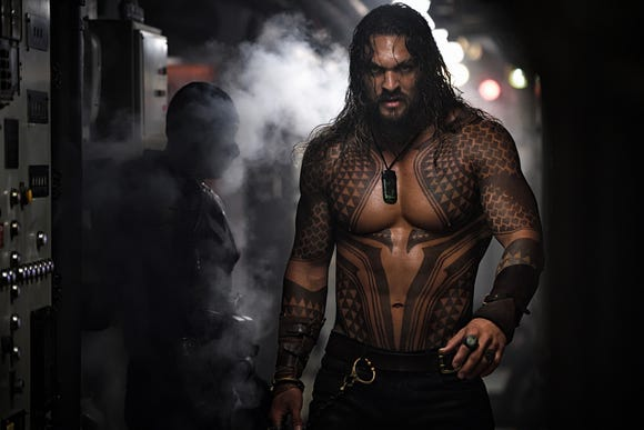 "Jason Momoa strikes a muscular figure as the title hero of ""Aquaman."" (Photo: JASIN BOLAND)"