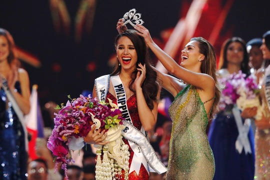 Catriona Gray of the Philippines is crowned Miss Universe 2018 by Miss Universe 2017 Demi-Leigh Nel-Peters of South Africa during the Miss Universe 2018 competition.