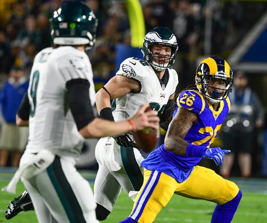 Philadelphia Eagles quarterback Nick Foles looks at Philadelphia Eagles tight end Zach Ertz (86), who is defended by the Los Angeles Rams' Mark Barron (26) in the second quarter at Los Angeles Memorial Coliseum.