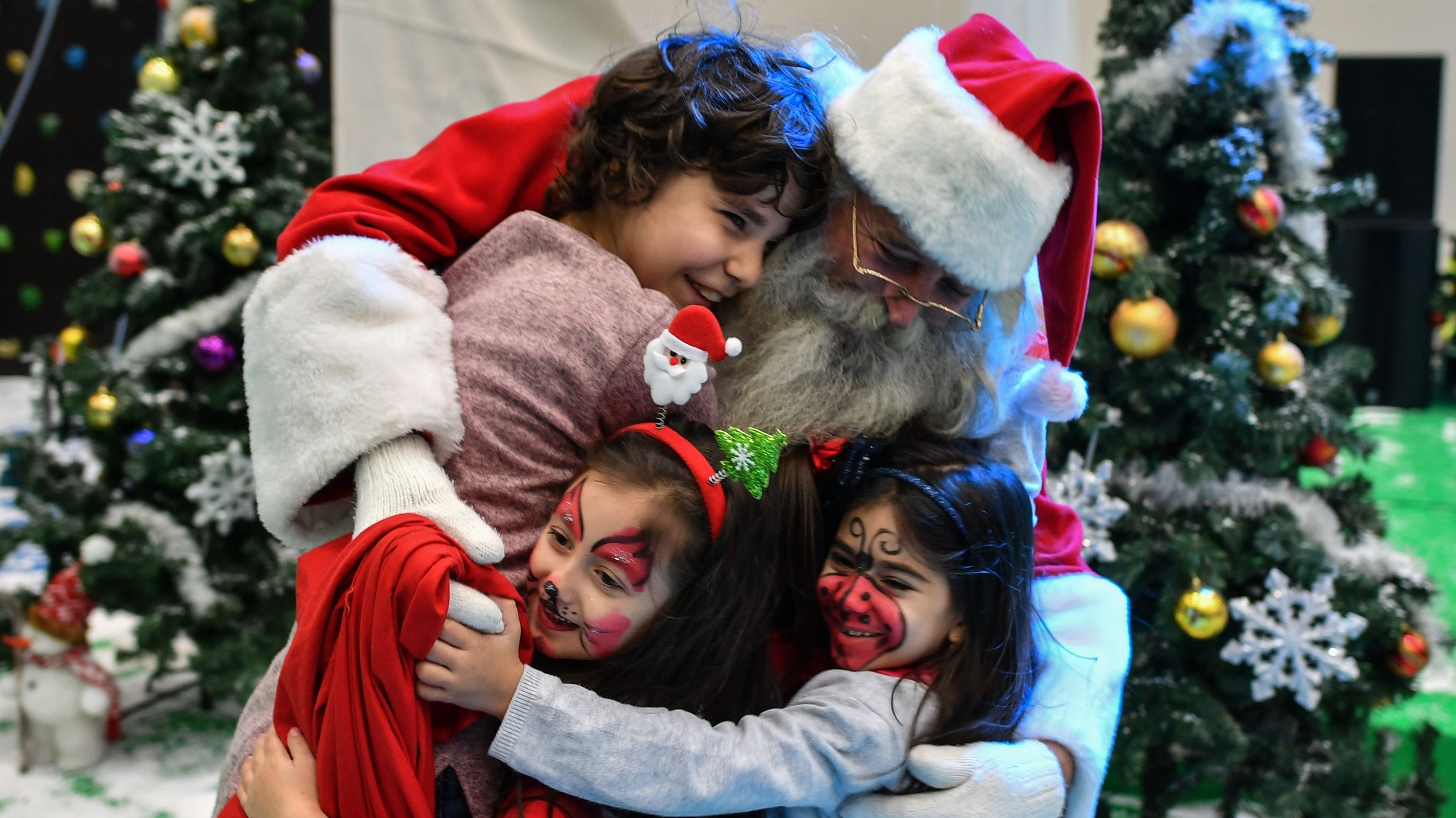 mom writes santa claus letter for parents working on christmas