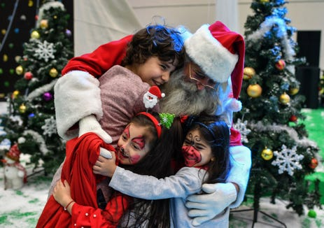 Santa Claus explains that Christmas is not about a calendar date, but about family in the letter.