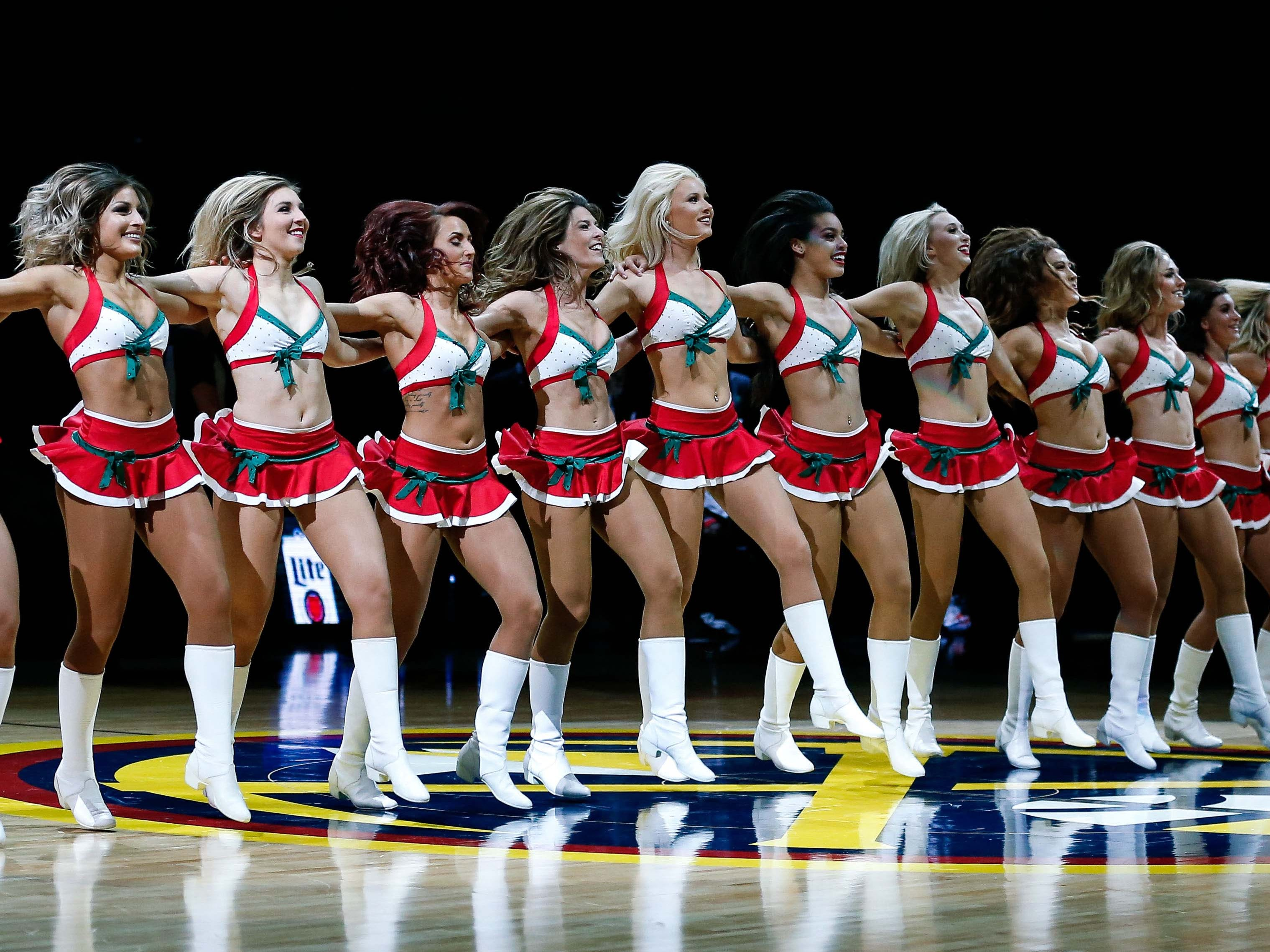 Dec. 16: Nuggets dancers perform a festive routine at the Pepsi Center in Denver.