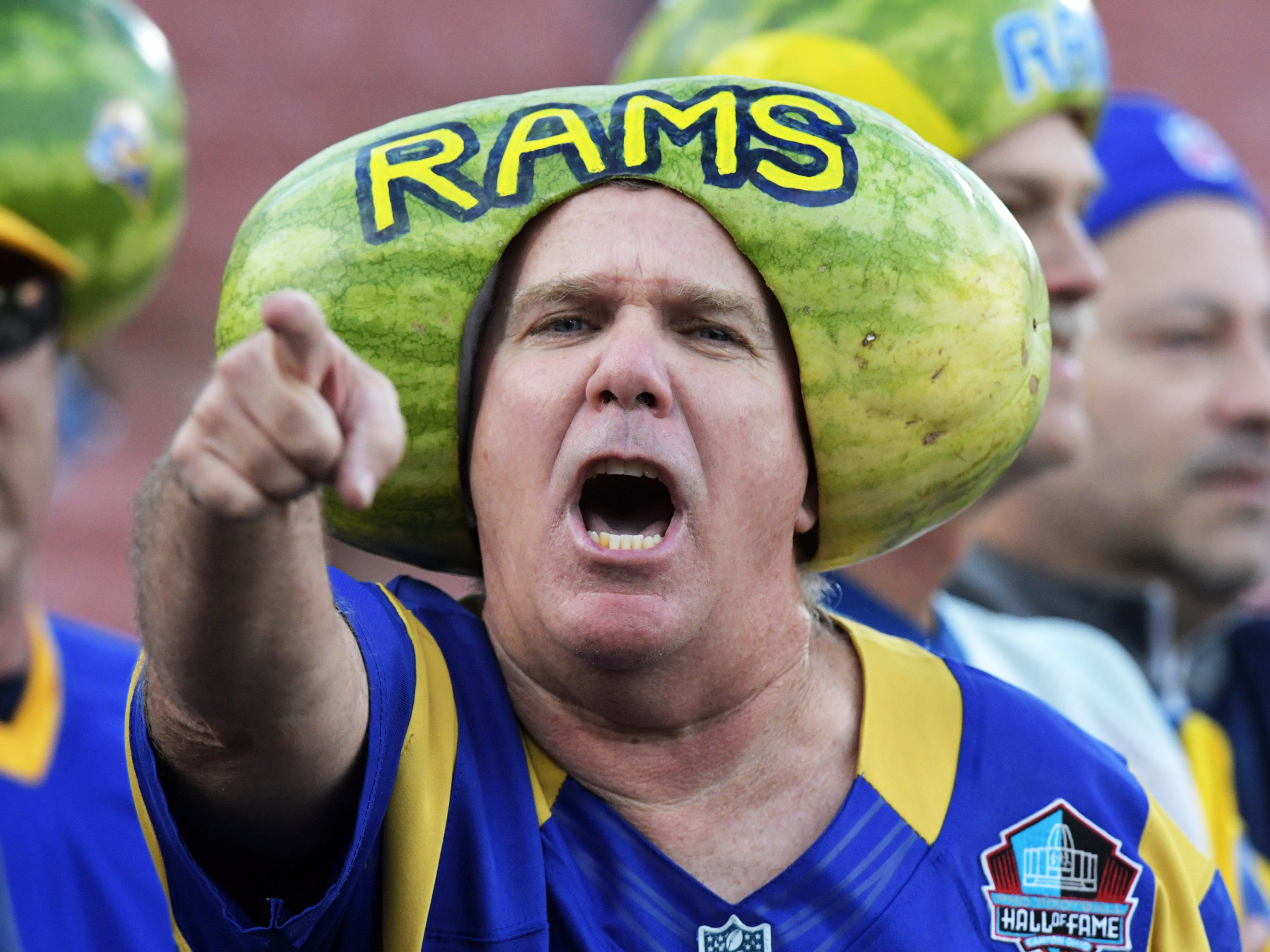 A Los Angeles Rams fan wearing a watermelon on his head reacts during the game against the Philadelphia Eagles  at Los Angeles Memorial Coliseum.
