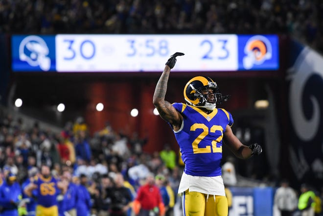 Cornerback Marcus Peters of the Los Angeles Rams urges on the crowd during the fourth quarter against the Philadelphia Eagles at Los Angeles Memorial Coliseum on December 16, 2018 in Los Angeles, California.
