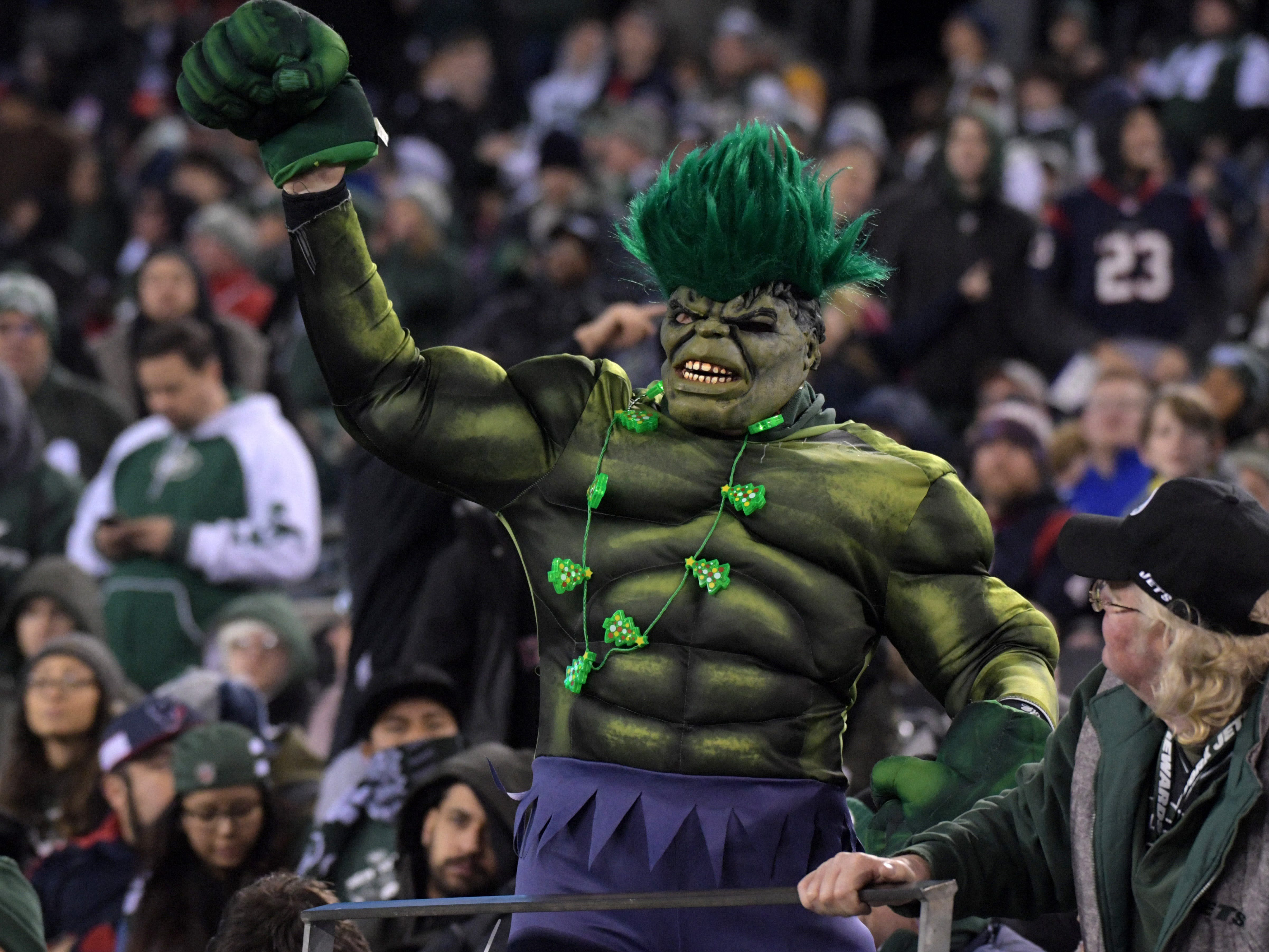 A New York Jets fan dressed as the Green Giant reacts in the fourth quarter against the Houston Texans at MetLife Stadium.