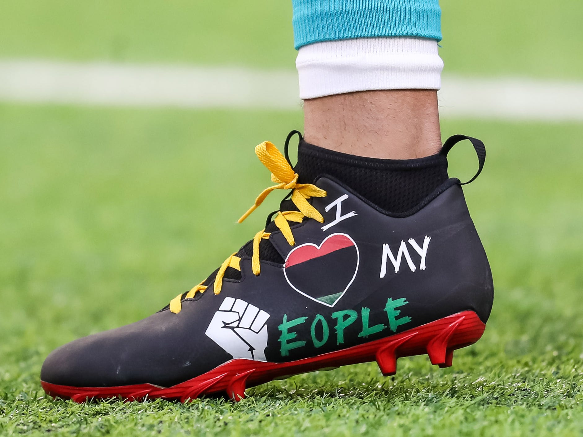 The shoes of Miami Dolphins wide receiver Kenny Stills prior to the game against the Minnesota Vikings at U.S. Bank Stadium.