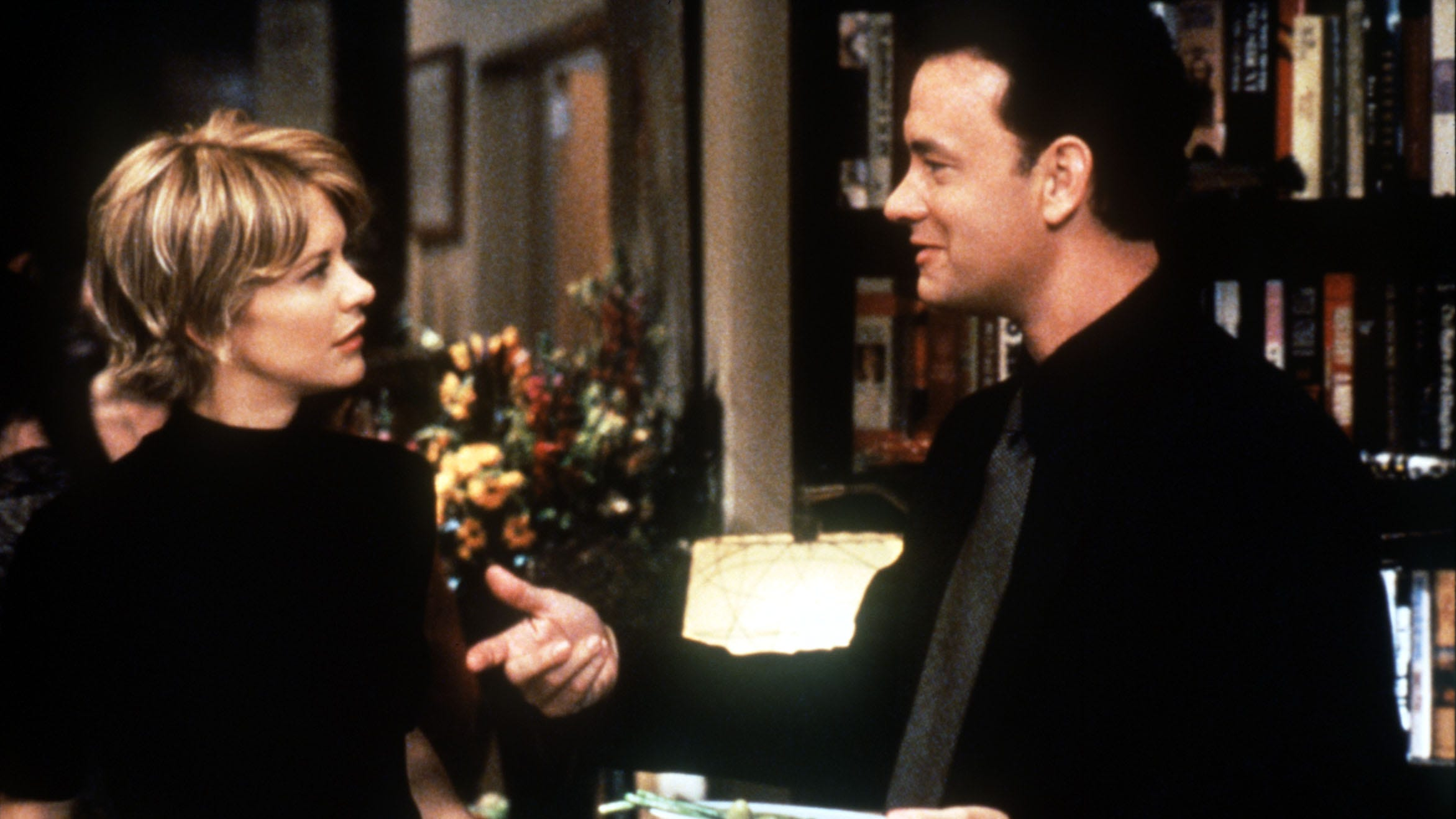"""Tom Hanks and Meg Ryan in a scene from """"You've Got Mail""""... and now you have the AOL dial-up sign-on sounds in your head."""