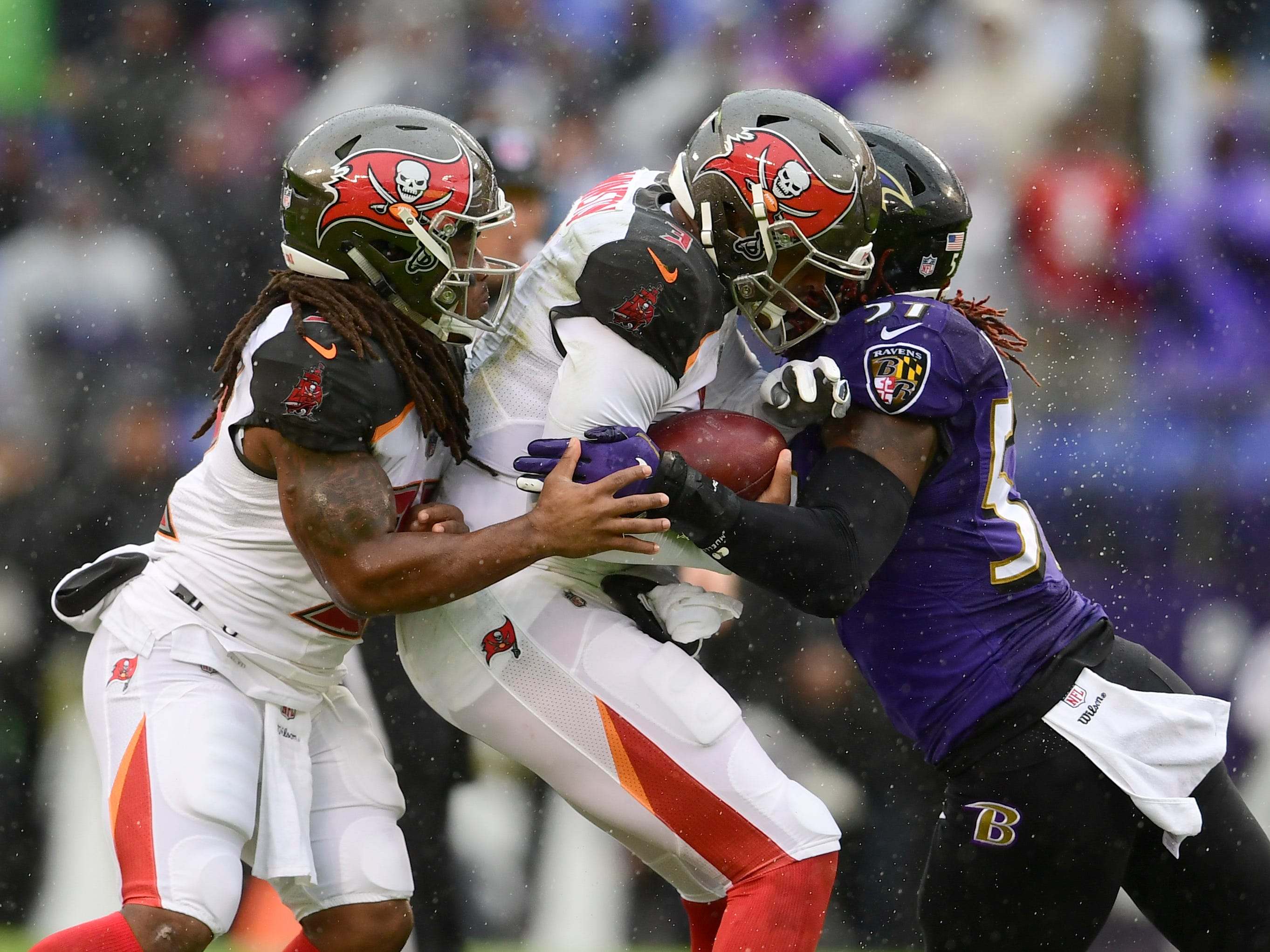 Week 15: Baltimore Ravens linebacker C.J. Mosley sacks Tampa Bay Buccaneers quarterback Jameis Winston  in the rain at M&T Bank Stadium. The Ravens won the game, 20-12.