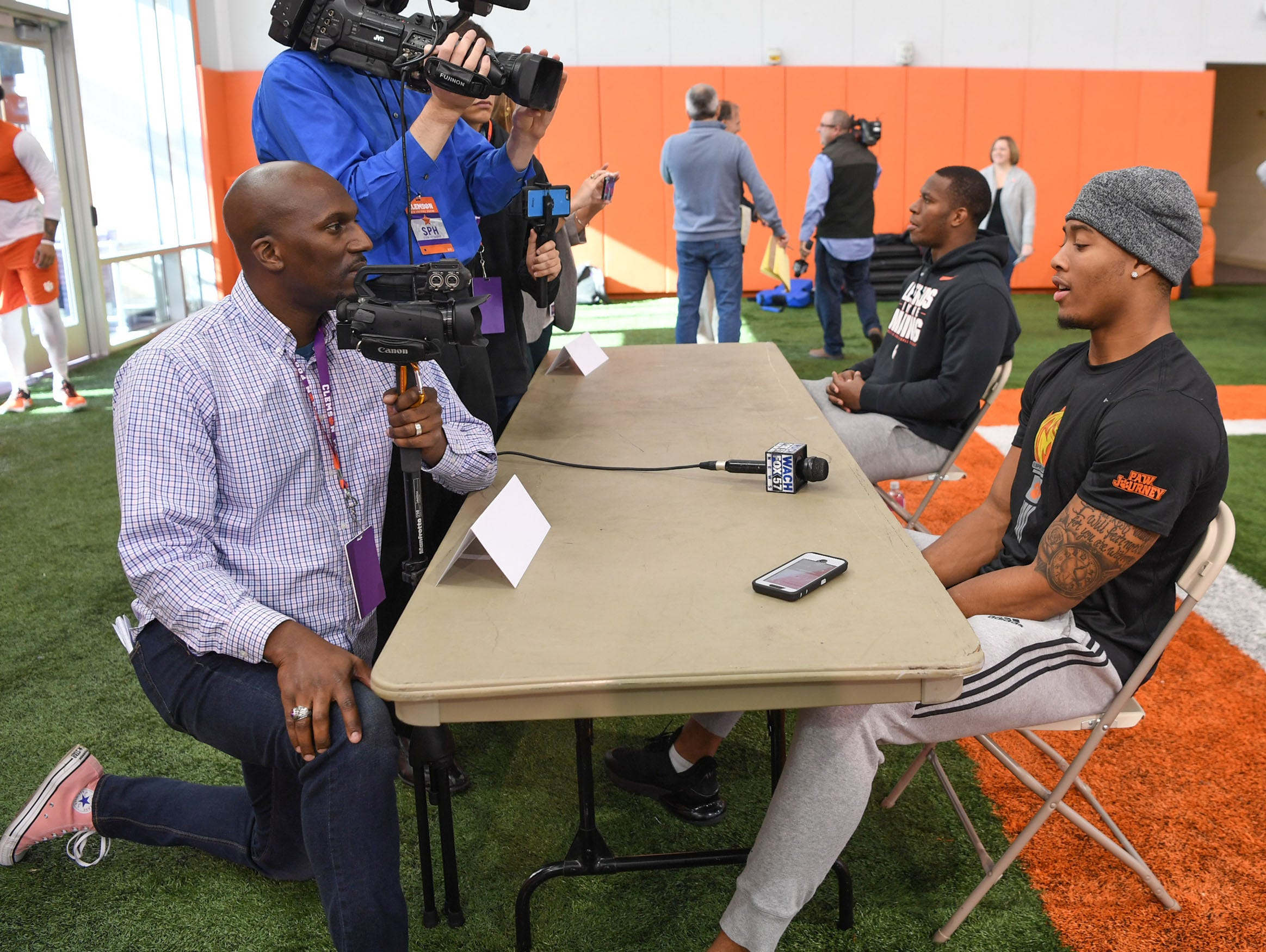 Manie Robinson, left, Greenville News reporter, interviews Clemson safety Isaiah Simmons, right, during Media Day at the Poe Indoor Facility in Clemson on Tuesday.