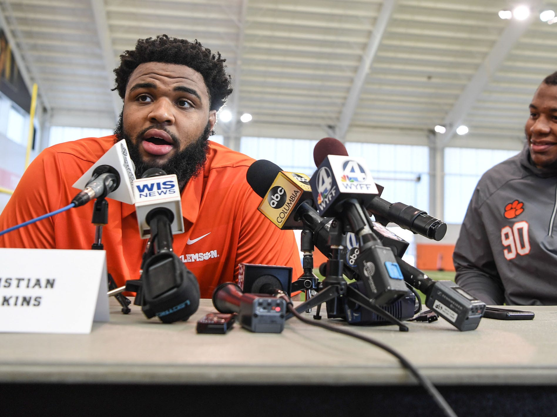 Clemson defensive lineman Christian Wilkins is interviewed as defensive lineman Dexter Lawrence, right, sits near him during Media Day at the Poe Indoor Facility in Clemson on Tuesday.