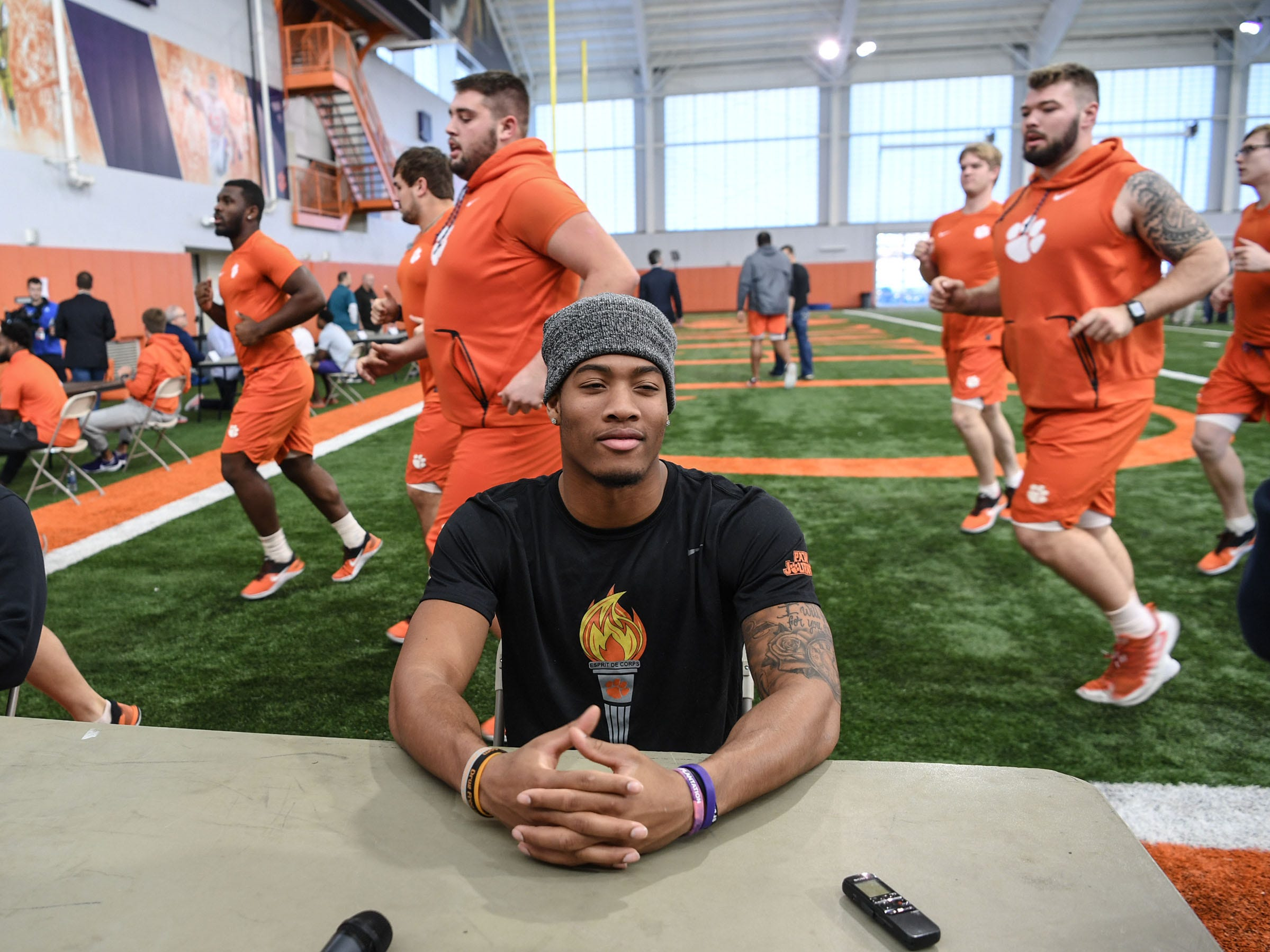 Clemson safety Isaiah Simmons waits to be interviewed while players jog by him, during Media Day at the Poe Indoor Facility in Clemson on Tuesday.
