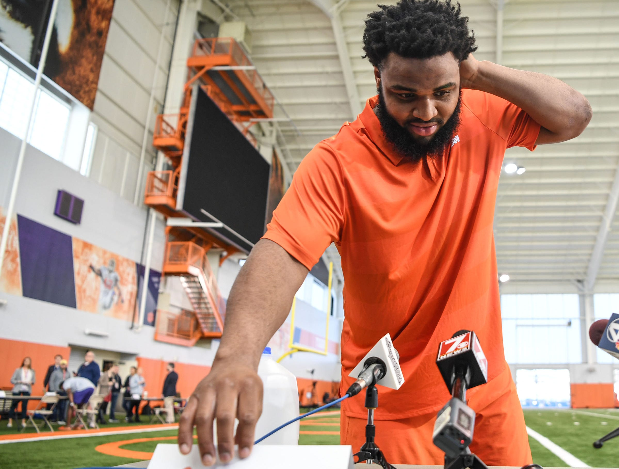 Clemson defensive lineman Christian Wilkins rearranges his name card with Dexter Lawrence before he is interviewed during Media Day at the Poe Indoor Facility in Clemson on Tuesday.