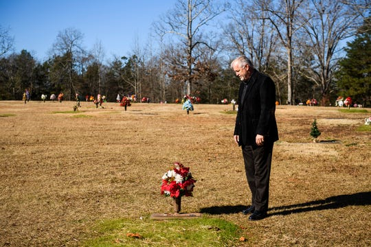 Scott Wade looks down on his son Hampton's grave at Cannon Memorial Park on Monday, Dec. 17, 2018, two months after he died in a motorcycle accident.