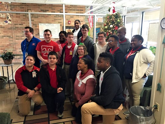 Some of the students at Tioga High School who participated in a drive to buy presents for less fortunate kids pose for a picture at Mary Goff Eelementary.